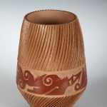 A micaceous pot by Dominique Toya and Nancy Youngblood, available at the live auction.