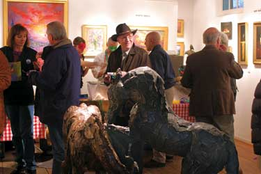 Siri Hollander sculptures and a crowd of art enthusiasts at Canyon Road Fine Art