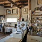 His studio includes a kitchen area and desk.
