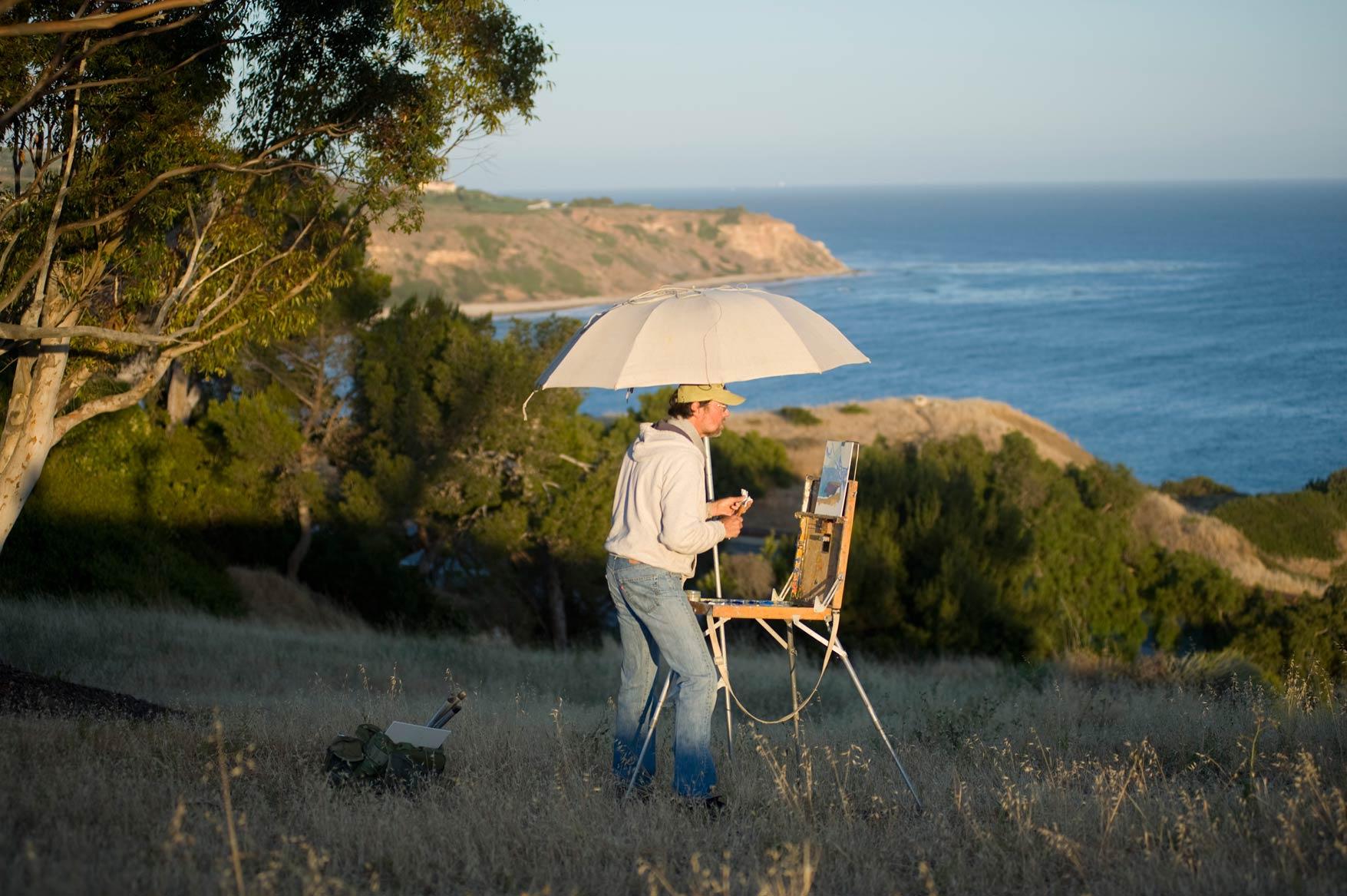 Daniel paints on location