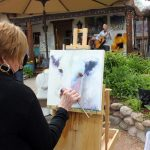 An artist works on Canyon Road during last year's Spring Art Festival.