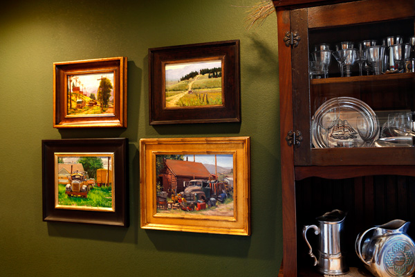 Four works depicting old trucks by Teresa Vito, Carol Jenkins, Tom Lockhart, and Douglas Morgan in Bullard's mountain home.