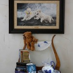 A painting of dogs in the bedroom reflects the Dunns' love of animals.