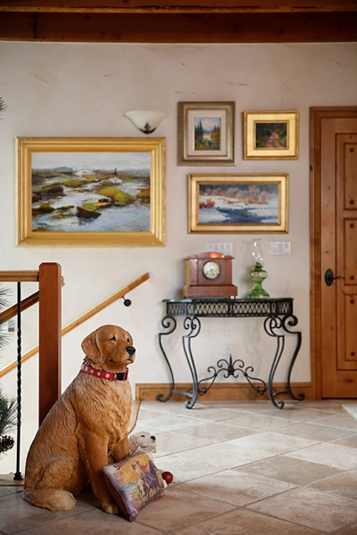 Dog-with-Cecy-Turner-and-Liz-Abeyta-paintings-Dining-area-to-sunroom-stairs
