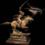 Ed Natiya, Final Charge, bronze, 30 x 36 x11 D.