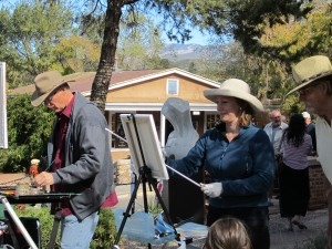 Artists paint and attendees peruse the galleries along Canyon Road at last year's event.