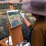 Utah artist Nancy Monteith paints above the Escalante River headwaters.