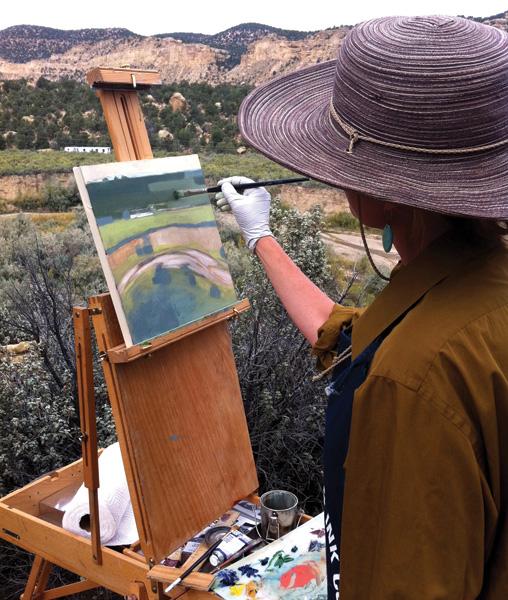 Utah artist Nancy Monteith paints above the Escalante River headwaters.