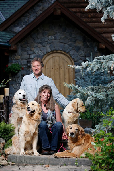 Mark and Retta Dunn and their four golden retrievers.