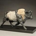 Pete Zaluzec | Running Bull, river stone/bronze, 15 x 9 x 6.