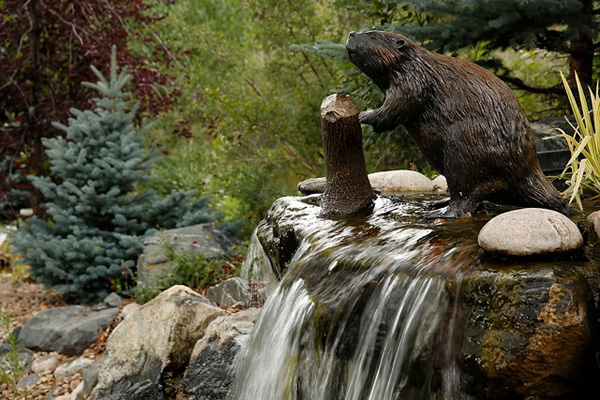 Wildlife sculpture by Stephen LeBlanc is placed throughout the Dunns' property.