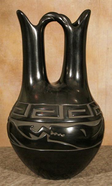 Elizabeth Naranjo, Santa Clara Wedding, carved blackware, 19 x 12. Estimate: $9,000-$12,000.