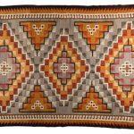 Western Reservation floor rug, circa 1950, 13 x 7 feet. Estimate: $9,000-$12,000.
